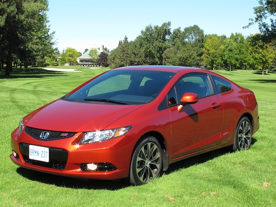 2013 Honda Civic Si Coupe Orange front side view on grass