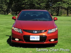2013 Honda Civic Si Coupe Orange front view on grass