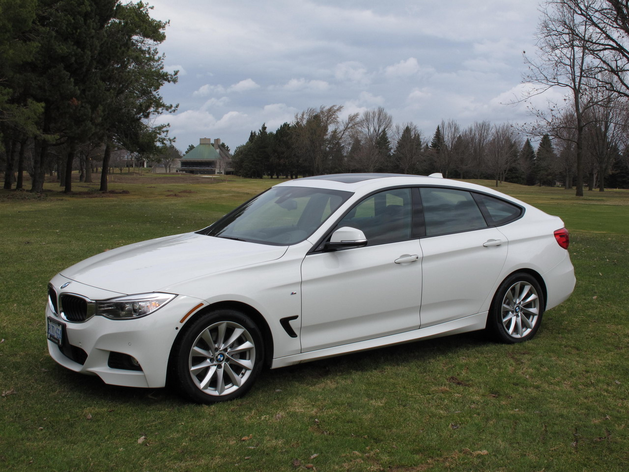 2014 bmw 335i gt white front side view