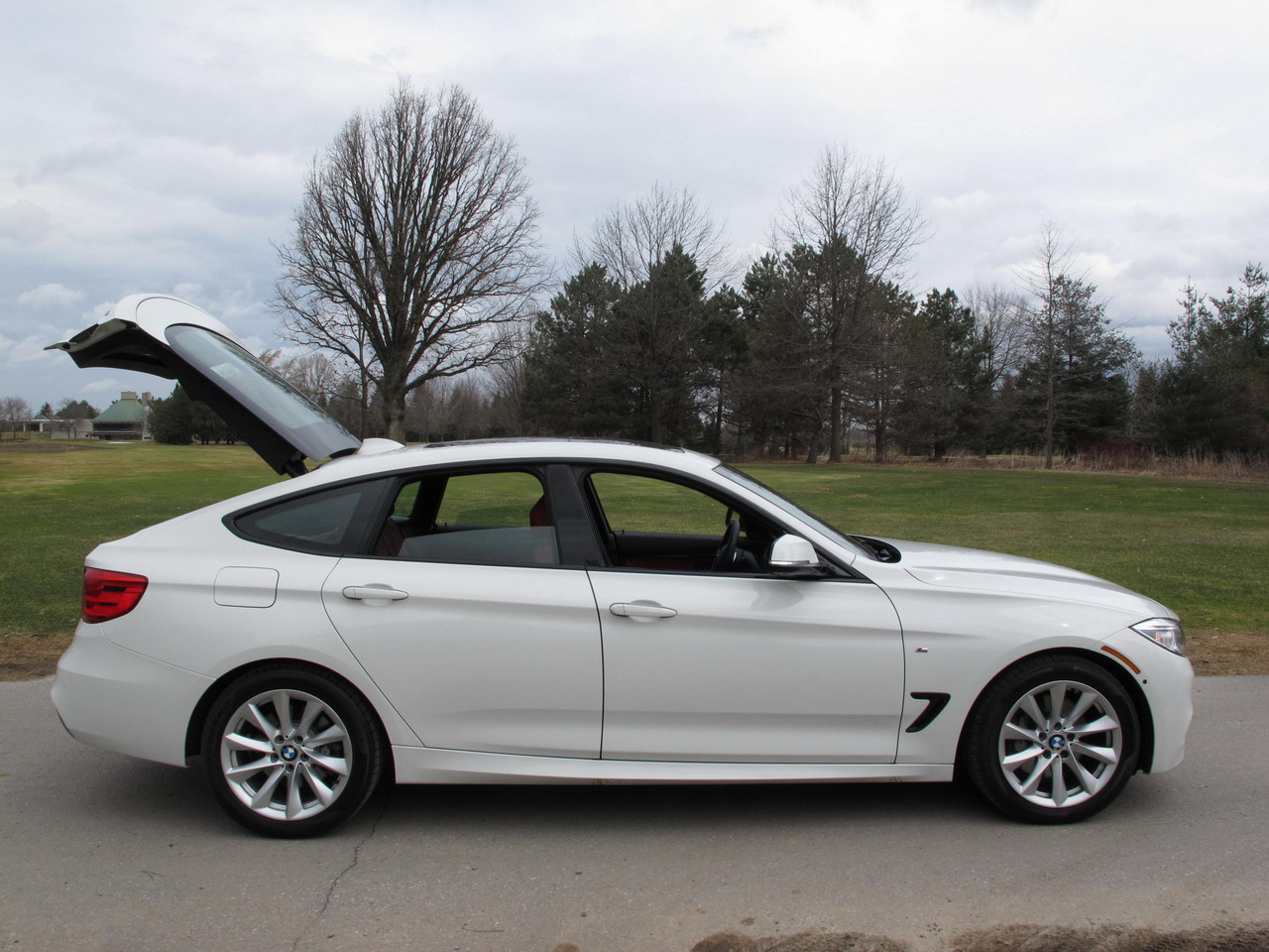 2014 bmw 335i gt white side view trunk open