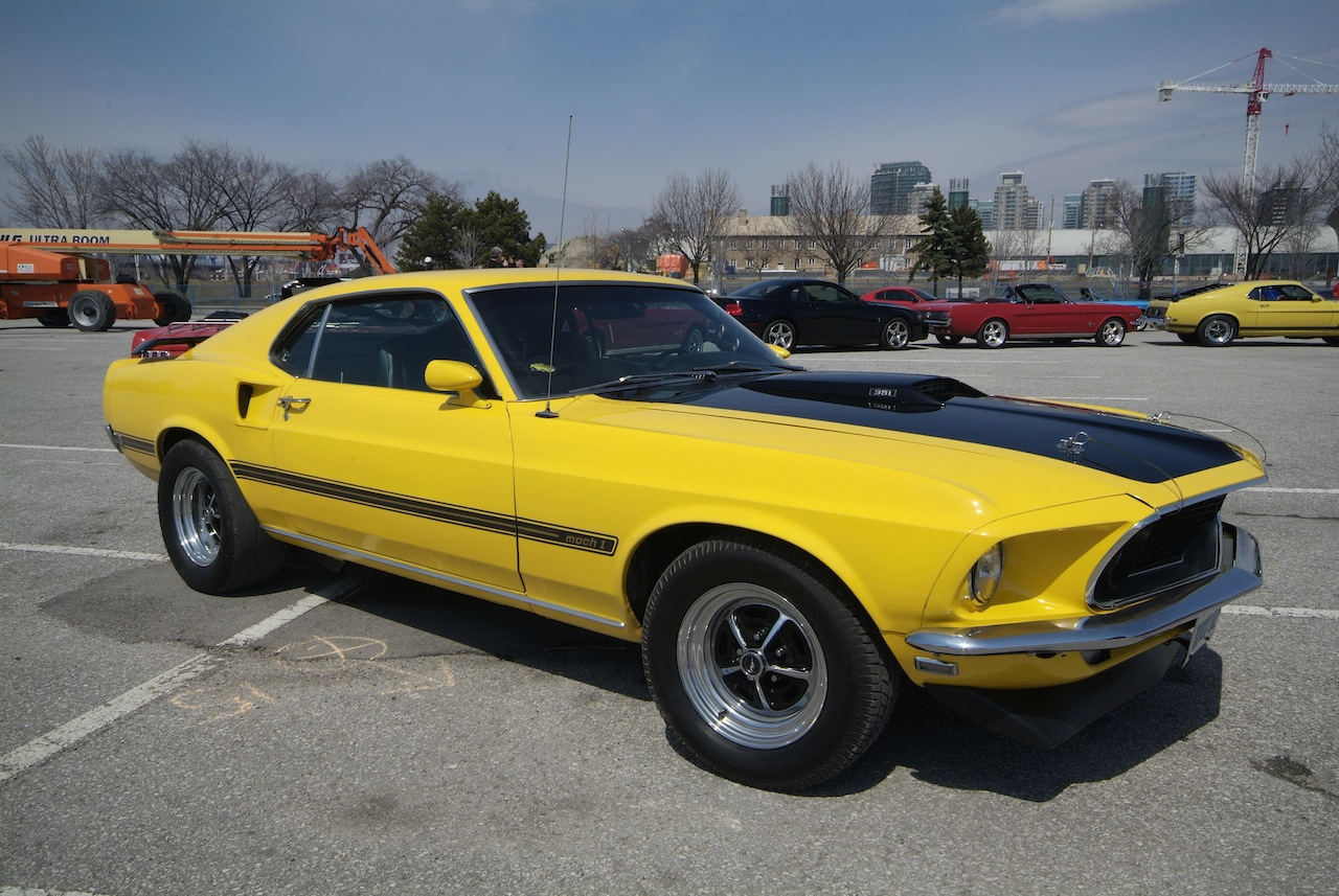 1967 ford mustang gt convertible blue 1969 ford mustang mach 1 yellow 1970 ford mustang boss