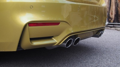 2015 BMW M4 Coupe Austin Yellow quad exhaust