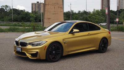 2015 BMW M4 Coupe Austin Yellow front side