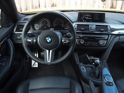 2015 BMW M4 Coupe Austin Yellow interior steering wheel