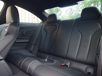 2015 BMW M4 Coupe Austin Yellow rear seats legroom