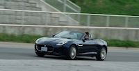 2015 Jaguar F-Type V6 Convertible Indigo Blue Metallic driving shot