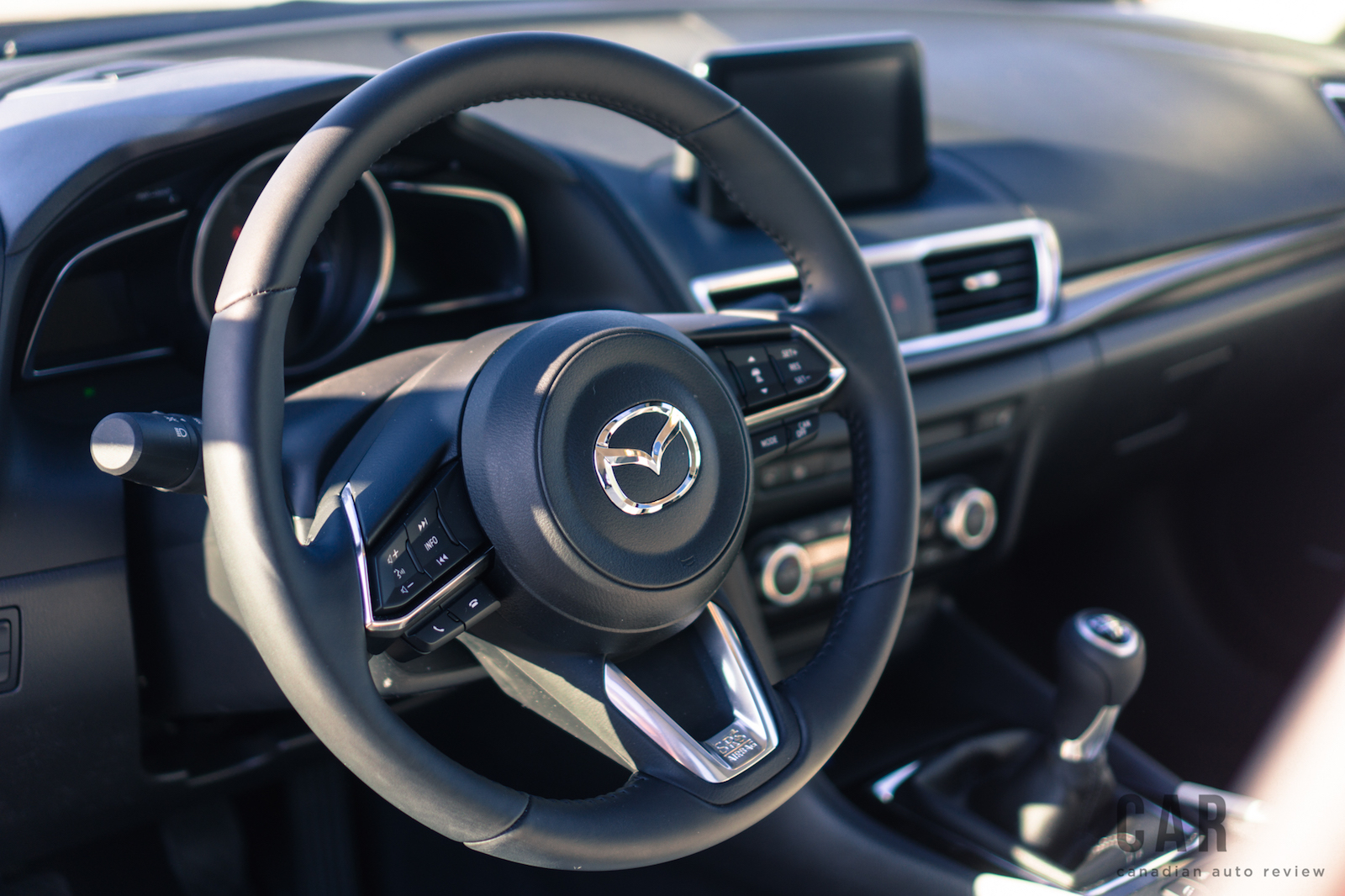 Review 2017 mazda3 gt manual canadian auto review for Mazda 3 2017 hatchback interior