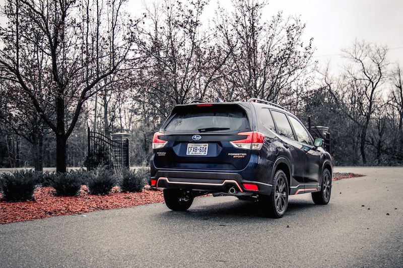 2019 Subaru Forester Sport dark blue paint rear quarter view